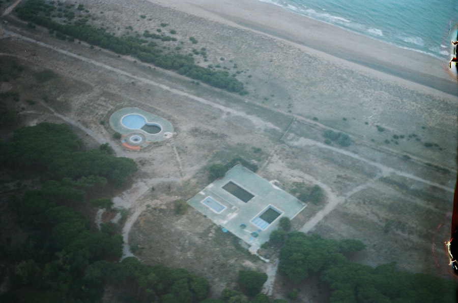 huge empty swimming pools by the beach